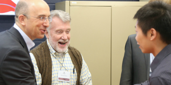 A group of CPES researchers catch up during a conference.