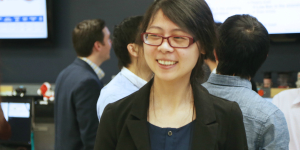 A CPES researcher smiling during a conference.