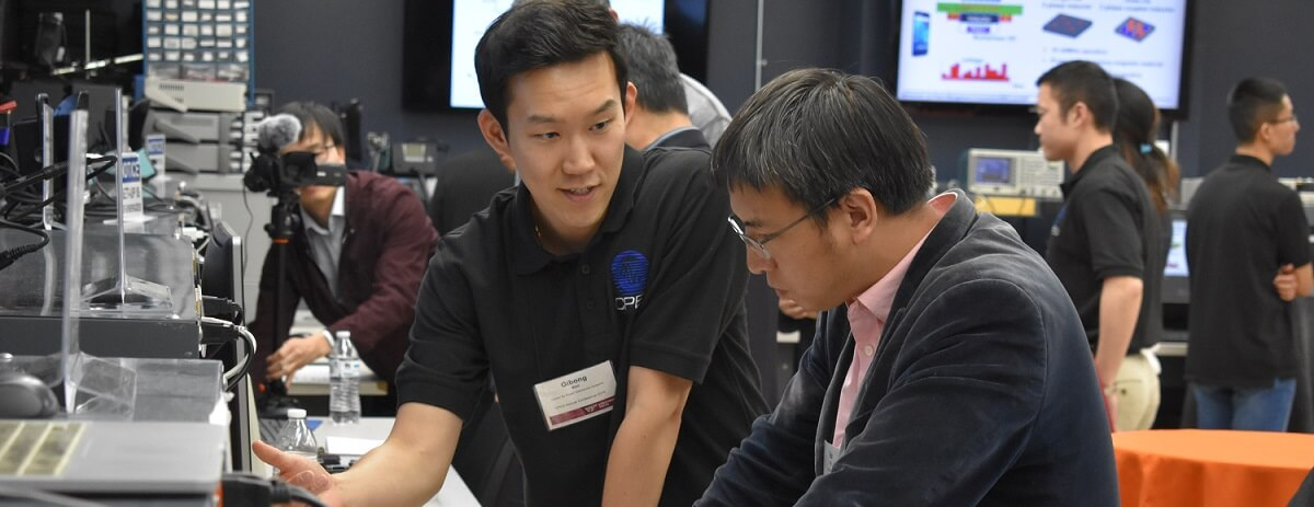 Two men discussing lab research at the 2019 C