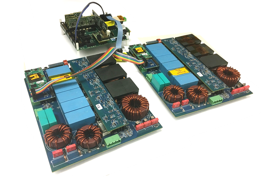 Image of Paralleled modular motor drives and the central controller.